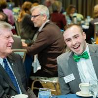 Benjamin Parsell laughing with President Haas at Scholarship Dinner 2019